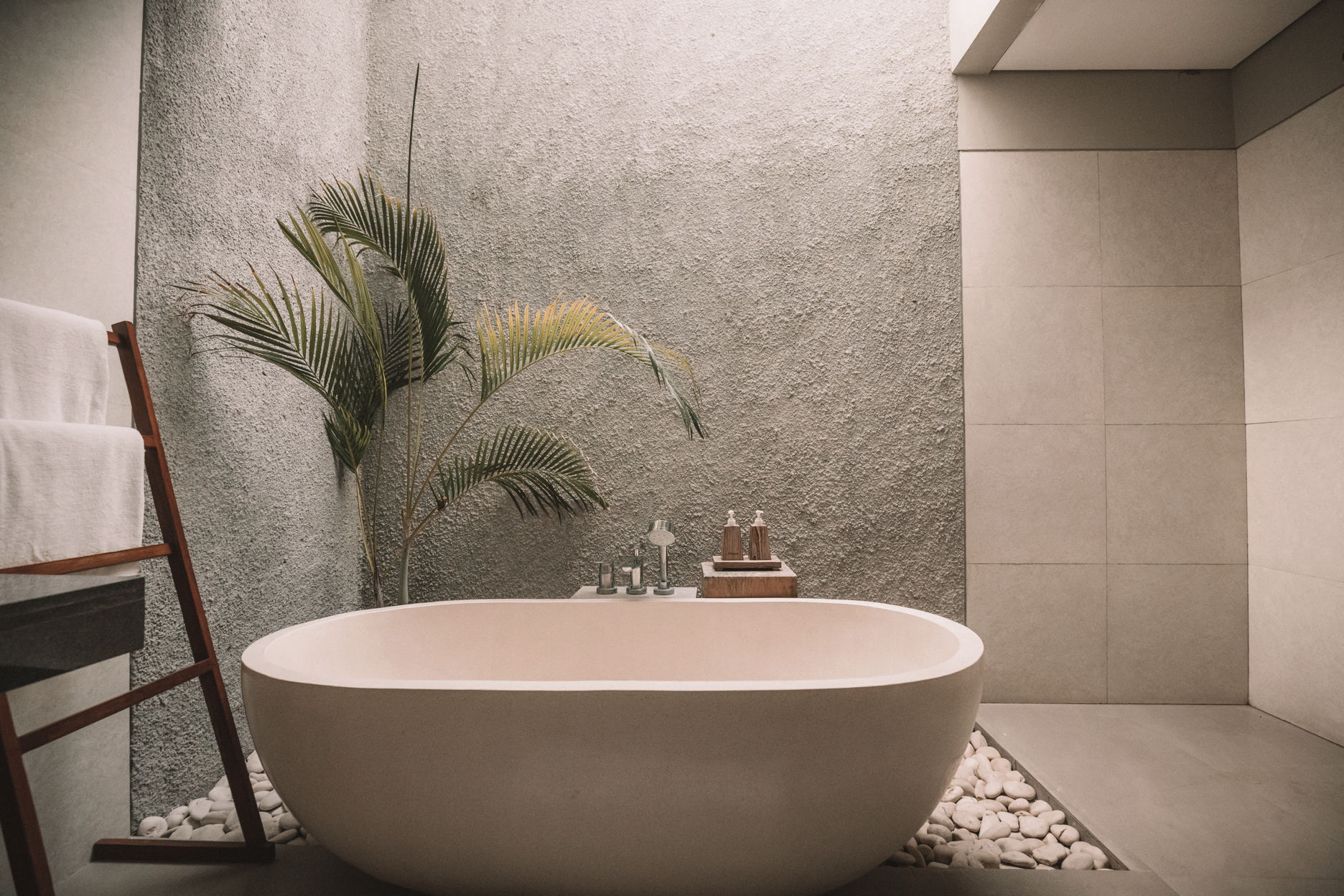 Preparing your bath according to our tips for the ultimate at-home spa retreat.